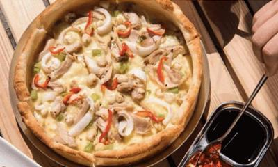 """火锅披萨、烤鱼披萨...""""披萨+中餐""""流行的背后有哪些餐饮趋势?"""